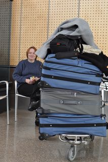 C & airport waiting luggage